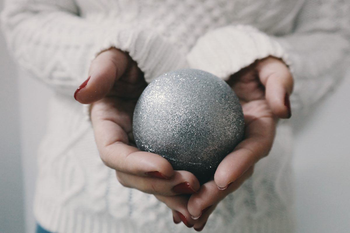 Relaxed lady holding bauble